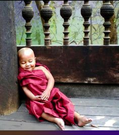 small Buddhist monk in training having a little lie down
