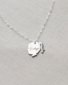 Silhouette Charm Necklace by Olive Yew. This detailed sweet little girl silhouette necklace can be of your child, grandchild, or anyone else you want to keep close to your heart. Also, make it even more personal by having an initial or name engraved on the silhouette.
