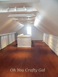 Attic Remodel knee wall closet and built in dressers and cubbies white beams and track lights cathederal ceiling