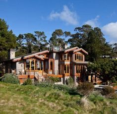 """This stunning modern Craftsman house rose on the foundations of a tired """"oversize rambler"""" that sported a concrete-block first floor and stingy metal windows."""
