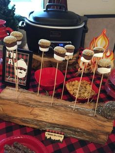 S'mores on a stick at a lumberjack birthday party! See more party ideas at CatchMyParty.com!