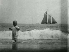 PLAY: Children in the Surf, Coney Island 1904. 3 minutes of jolly jumping in the surf and a schooner on the horizon. Then, there it is in the surf at water's edge. ▶️
