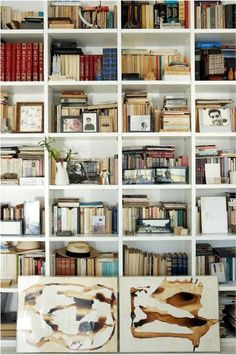 A well-curated bookshelf is something of an art form. A visually compelling mix of books, photos, objets d'arts, small oil paintings, stones from the beach adds a bookish and bohemian vibe to any room.