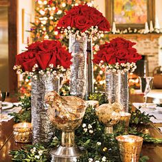 Pillar candles on a mirror platter and putting poinsettia pots on the table's center provides a romantic and elegant look. Ornaments vases can also be used for this purpose. Red roses can be used by filling them in a bowl that contains green pine tree branches also gives a festive look or you may place the wreaths in each table's center.