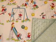 Midcentury modern baby blanket with sage green ultra soft minki dot fabric on one side and fun playground slides and swings artwork on the other.
