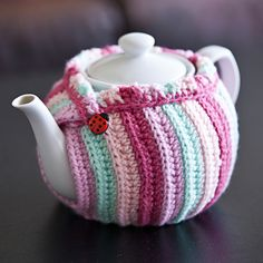 Pink crocheted tea cosy, leaves the lid accessible for stirring! No pattern