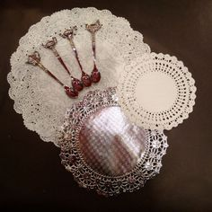 Elegant silver doilies to showcase your pastries. Tiny teaspoons with vintage teapot toppers. ‪#‎doilies‬ ‪#‎silver‬ ‪#‎teaspoons‬ ‪#‎afternoontea‬ ‪#‎teaparties‬ ‪#‎shabbychic‬ ‪#‎entertaining‬ ‪#‎pastries‬