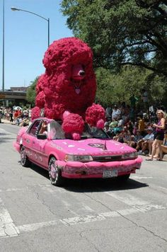 Poodle Parade Float~ Uh... Um... Well, looks like it's a car thinga-ma-jig with a giant pink poodle on top