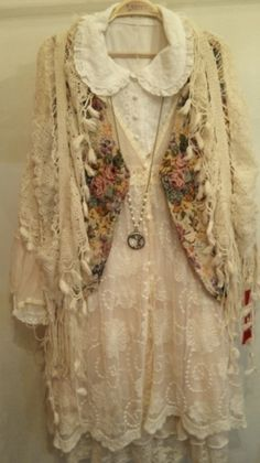a mixture of antique laces and tapestry vest