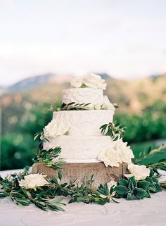 The base of the cake stand will be surrounded by bay laurel, dusty miller, eucalyptus, and magnolia leaves.