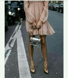 light pink long sleeve dress with silver and gold accessories. classic style.