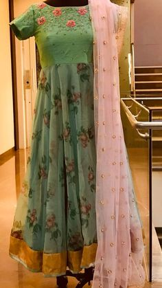 Beautiful powder blue color floor length anarkali dress with blush  pink color net dupatta. Ananrkali dress with floret lata design hand embroidery thread work.  25 July 2018
