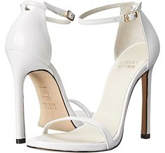 """Olivia Wilde is White Hot in A.W.A.K.E. Dress and Stuart Weitzman Sandals at Revlon """"Love Is On"""" Million Dollar Challenge"""