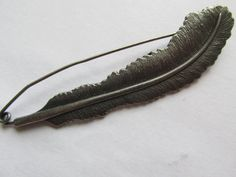 Kilt Pin / Shawl Pin Feather by TheIrishKnittingRoom on Etsy Shawl Pin, Kilt Pin, Kilts, Shawls, Feather, Wraps, Trending Outfits, Unique Jewelry, Handmade Gifts