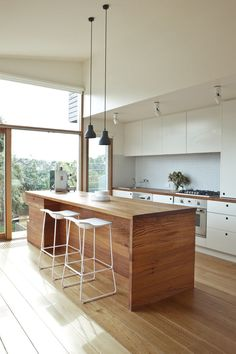 Sliding doors. Louvre windows to side. Window strip above door height. Width floorboards Contrast island colour