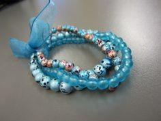 A bundle of elasticated bracelets in tones of aqua, turquoise and pale blue. Made from various glass beads - two tone brown and blue drizzle beads, duck egg blue drizzle beads and frosted sea-blue beads. Three bracelets in total, can be worn together o. Stretch Bracelets, Beaded Bracelets, Conkers, Aqua, Turquoise, Duck Egg Blue, Blue Beads, Dyi, Stretches