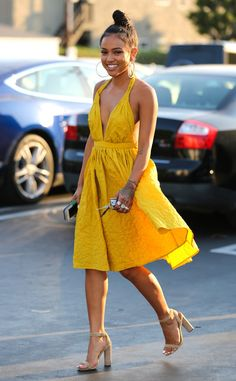 The model looks radiant in yellow out todinner with friends in West Hollywood.