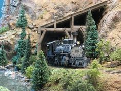 D&RGW #461 emerges from a rock shed and continues its battle upgrade on Mike Schwab's beautiful Sn3 layout. Detail is the hallmark of every great layout.