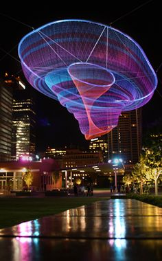 Janet Echelman is transforming urban spaces with billowing, soft, volumetric sculptures scaled to skyscrapers which are idiosyncratic, ephemeral and fluid in the wind.