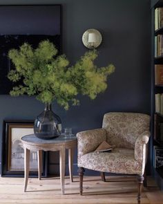 """Smoke bushes are so dramatic in the landscape,"" Ngo says. ""I cut big branches to re-create that feeling indoors."" The dark walls accentuate the mysterious fogginess of the silhouette."