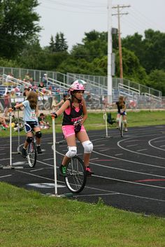 A-Z sports letter U - Unicycling  a girl unicycling