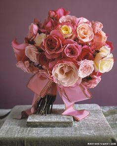 This fragrant bundle puts the classic garden rose on display. Wide pink ribbon edged in brown blends seamlessly with this bouquet.