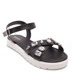 15497a6d60492 Flat women s sandals in black colour with cross-over band straps decorated  with white gemstones