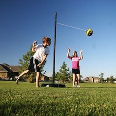 Make a tetherball yourself by either sinking a pole into the ground, or setting one in concrete inside an old tire.