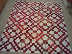 Jacob's Ladder quilt in reds and creamy white. . .I even have the Thangles.