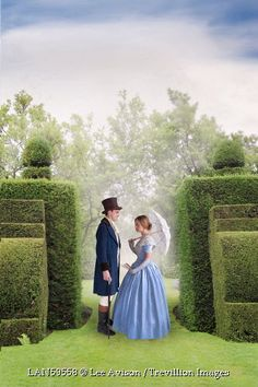 © Lee Avison / Trevillion Images - Victorian-man-and-woman-standing-in-gardens