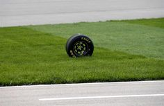 At-track photos: Saturday, Kansas:   Sunday, May 8, 2016  -   A loose wheel makes its way into the infield after cars come in for pit stops.  -   Photo Credit: Photo by Sean Gardner/NASCAR via Getty Images