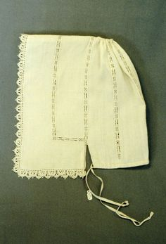 Linen coif with needlepoint lace insertions and edges. Composed of one length with narrow openwork hem at edges, folded in half and seamed from front edge half way to back at top with 0.5cm wide insertion of needlepoint lace, back is half-open; seven insertions of needlepoint lace parallel with front edge, evenly spaced round coif c.1640 Manchester City gallery