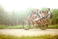 In Southeast Asia, most rural areas in the country rely on motorcycles to ferry residents to and from schools, work and market. Taken in the island of Leyte, Philippines.