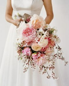 Bridal Bouquet A combination of flowers large (peonies and ranunculus), medium (sweet peas), and petite (jasmine and 'Hally Jolivette' cherry blossoms) gives this bouquet dimension.