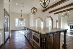 Wood Beams. Statement Dining Chandelier. Texas Spanish Kitchen. Bannister Custom Homes.