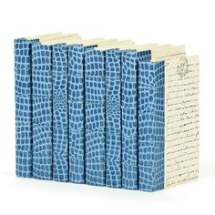 The Linear Foot of Croc Faux Blue Books are part of a line in Restoration Warehouse devoted to the importance of home, creature comforts, and things that make us feel safe that don't have to cost a fortune. It emphasizes the treasures that tie a house together and their direct link to your happiness. Restoration Warehouse is a selection of items that we find exciting and beautiful from around the world, and hope will inspire you and your clients.