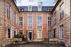 The Seguins' apartment is on the ground floor of a 17th-century mansion in the Marais district.