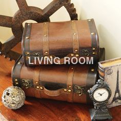 Love the stacked old luggage look.  Makes for great home decor and storage!
