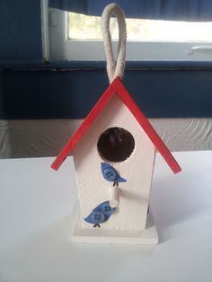 little wooden birdhouse with button birds.