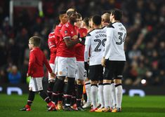 Paul Pogba of Manchester United shakes hands with Derby County players prior to the Emirates FA Cup Third Round match between Manchester United and...