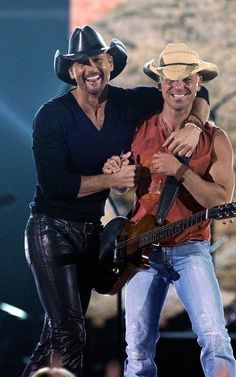 Kenny Chesney & Tim McGraw..... Could this picture get any hotter? Yes, Luke Bryan..BG.. should I keep going?