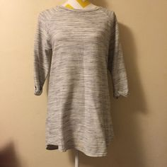 Topshop sweater Grey top shop sweater, zipper back and roll up sleeves. There is a tiny spot on one of the sleeve, shown in picture. Size 8 so a medium I believe Topshop Sweaters