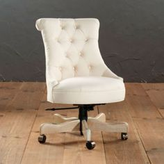 Available in several fabric colors and patterns, the Ballard Designs Elle Tufted Desk Chair has a vintage, glamorous look that would instantly dress up a desk space.