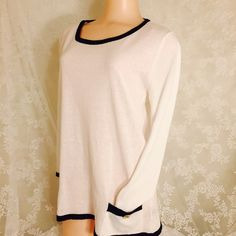 Black and white top Black and cream blouse w/gold buttons. 100% Cotton. This material gives you comfortable feeling. High quality. Feels more like a very light sweater. 2 front pockets. Classic and stylish. Zenobia Tops