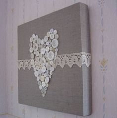 canvas, fabric, lace and buttons - does not have to be a heart. This could be done with letters or other simple shapes. Endless possibilities.