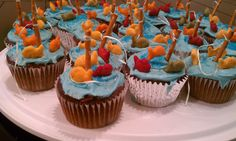 Cup cakes my 6 year old daughter and I made for father's day treat.  So fun!  Blue food coloring with white icing, pretzel sticks, color gold fish and a little dental floss and dad has Gone Fishing