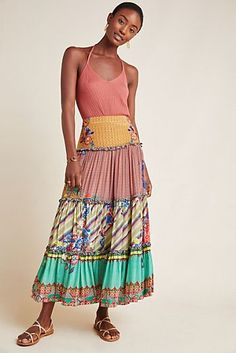 4151ed48c Presented by Anthropologie. This beautiful skirt had embroidered and sequin  embellishments with ruffled details.
