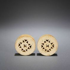 Africa | Zulu Wood Ear Plugs - South Africa | ca 1920s - 1940s | At an early age, a Zulu child's earlobes were pierced and gradually stretched to allow for larger and larger ear plugs to be worn.: