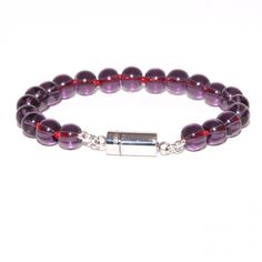 """YNFINITO - TRUE """"Style of Amethyst"""" Lavishly worked bead bracelet consisting of roundly cut gemstones in amethyst-purple. The patented CLICCESSORY clasp is made of high- gloss stainless steel. €34.00"""