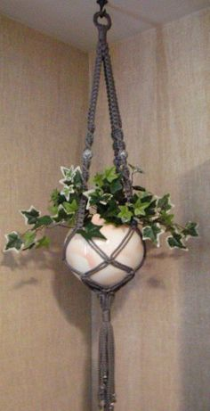 Macrame plant hanger instructions. Seems pretty much like friendship bracelets knots, only a lot bigger